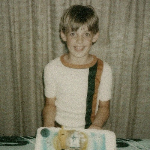 Here I am on my 9th Birthday back in '79. 70's shirt and Star Wars Cake in full effect.