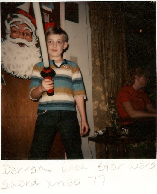 I have the POWER. Me with my lightsaber, mere moments after opening it. To my left is my Aunt Jan, who passed away in November of 94.